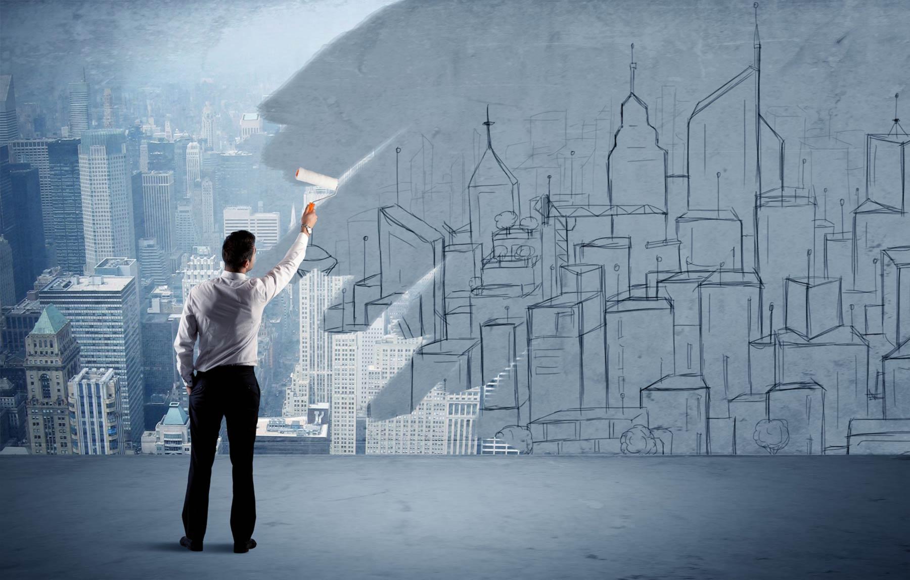 homme transformant à l'aide d'un pinceau une grande ville fictive en réalité